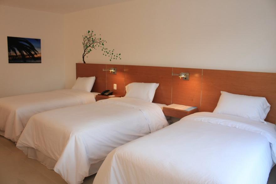 Sisai hotel boutique for Medidas cama twin en centimetros